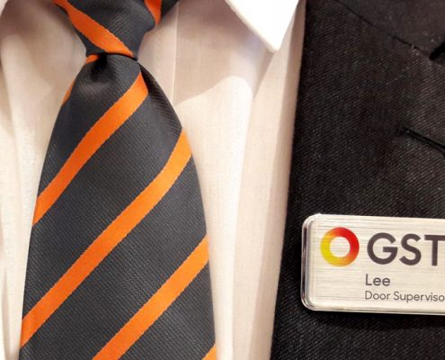 A tie showing GSTS security employee