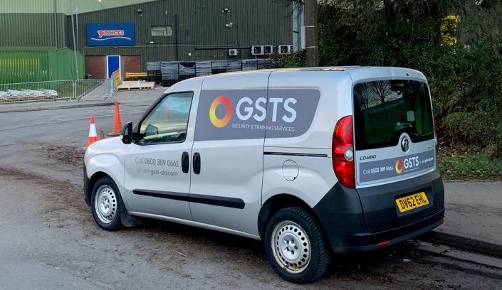 A GSTS security and training services van parked outside Princes Food Cardiff to provide security
